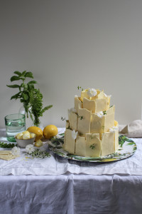 lemon poppy seed cake with lemon meringue frosting and white chocolate shards