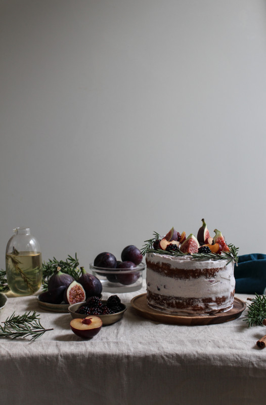 black tea poached fig and plum cake with rosemary blackberry frosting