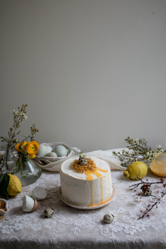 lemon poppy seed cake with honey black tea frosting and marigold nest