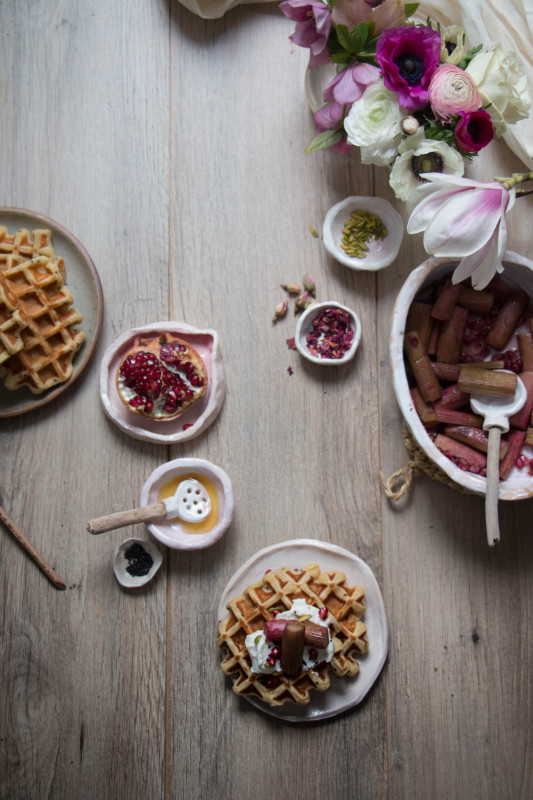 black sesame ricotta waffles with rose and pomegranate roasted rhubarb