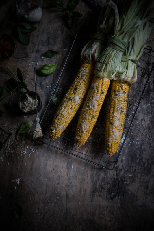 grilled corn on the cob with sundried tomato basil and garlic butter with parmesan