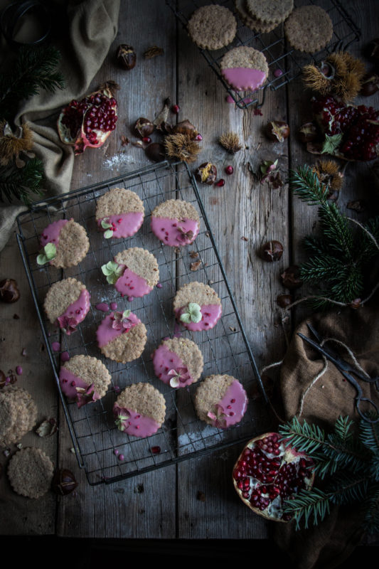 spiced chestnut cookies with pomegranate glaze