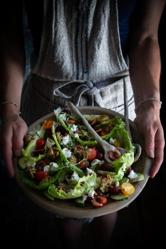 Picota cherry salad with goats cheese and savoury pesto granola croutons
